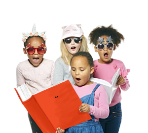 Four young children reading together with surprised expressions on their faces