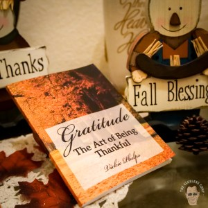 Gratitude: The Art of Being Thankful sitting on a table in a fall setting
