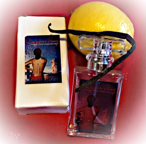 Image of lemon, clear perfume pottle with Singapore Fling cover images superimposed on front, a stalk of vanilla bean, and box wrapped in shiny white paper and a photo of Singapore Fling cover art sitting on top