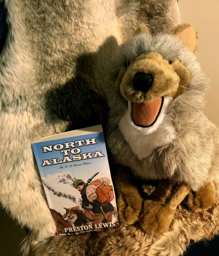 Bookstagram: Photo of paperback North to Alaska set amid a gray, stuffed animal.
