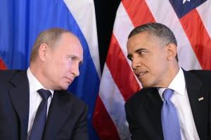 US President Barack Obama (R) listens to