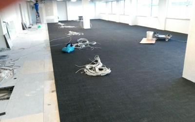 Colocación de moqueta técnica en losetas en Oficina de Lisboa