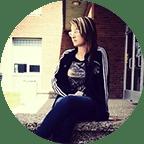 Alex model sitting on loading dock