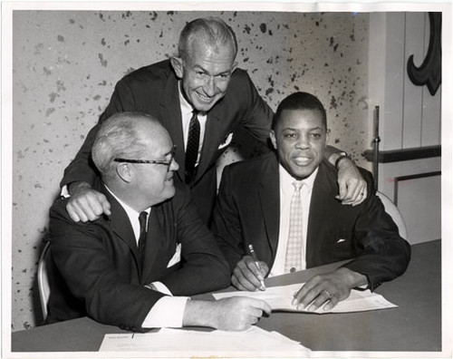 Willie Mays signing his 1960 baseball contract