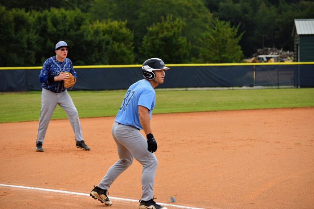 Brian Breiholz leads away from third base against the Raleigh Rebels on 8/29/2020