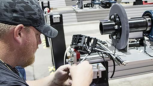 Technician working on Bend-Tech Dragon CNC Plasma Pipe Cutting Machine