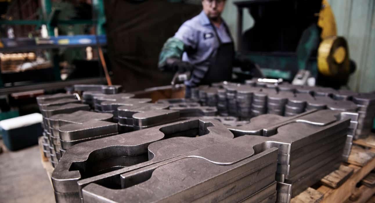 CNC Plasma Cutters; Man cutting various industrial/mechanical parts