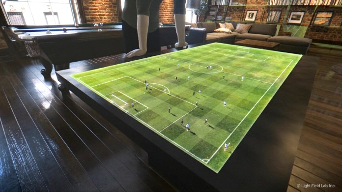 SolidLight Display's futuristic vision art showing a holographic soccer pitch