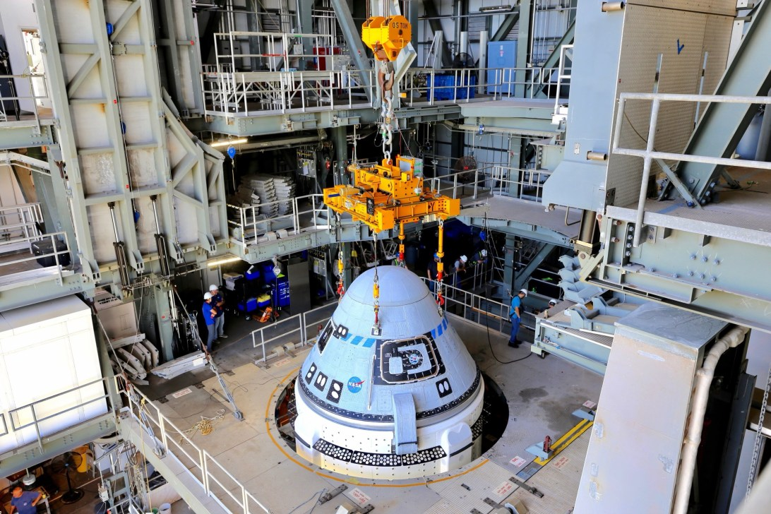Boeing's CST-100 Starliner spacecraft is secured atop a United Launch Alliance Atlas V rocket at the Vertical Integration Facility at Space Launch Complex-41 at Florida's Cape Canaveral Space Force Station on July 17, 2021.