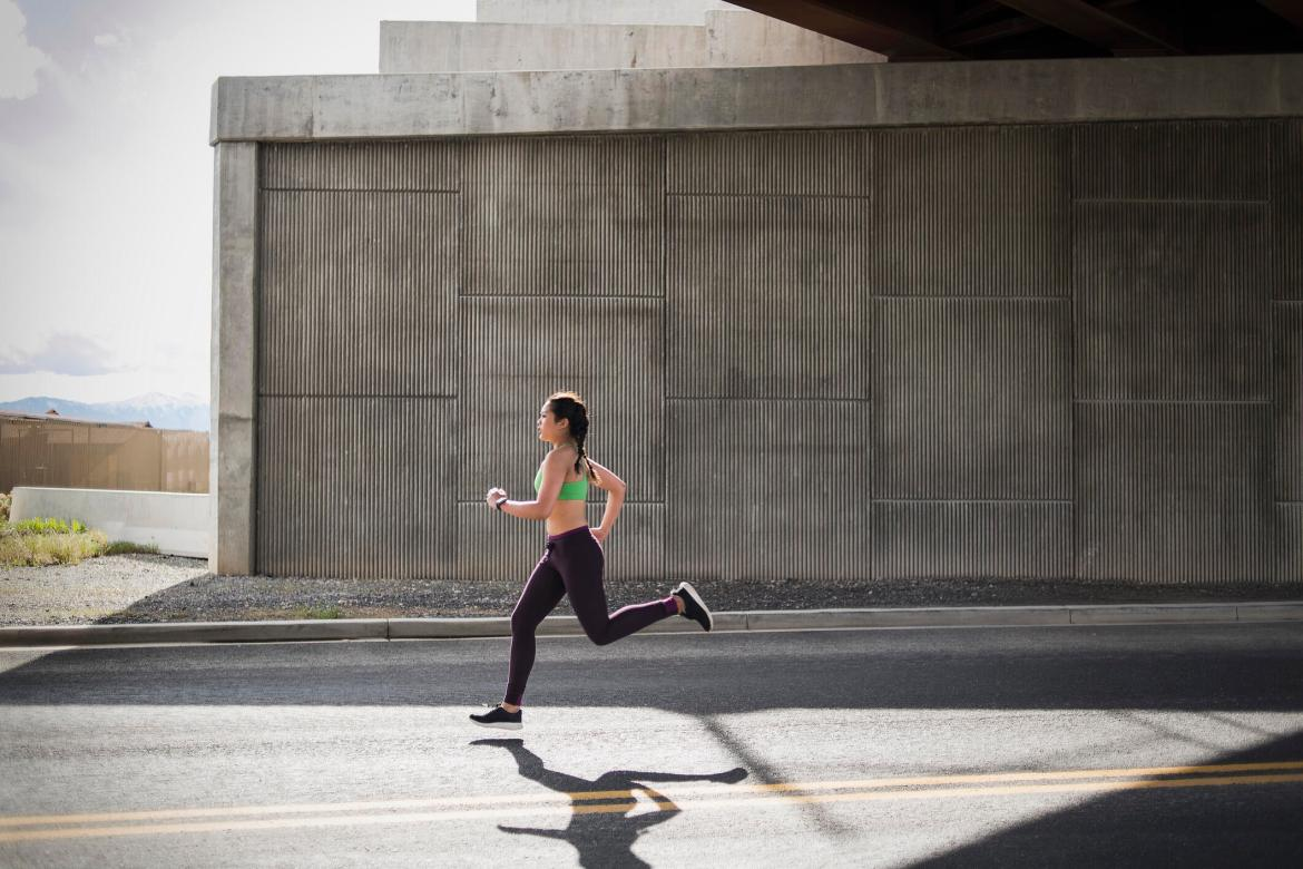 woman running on an empty street gettyimages-656983165