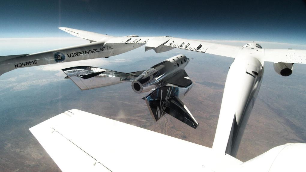 Virgin Galactic's SpaceSshipTwo pulls away from its launch aircraft