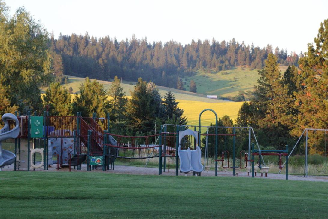 School playground in front of rolling hills