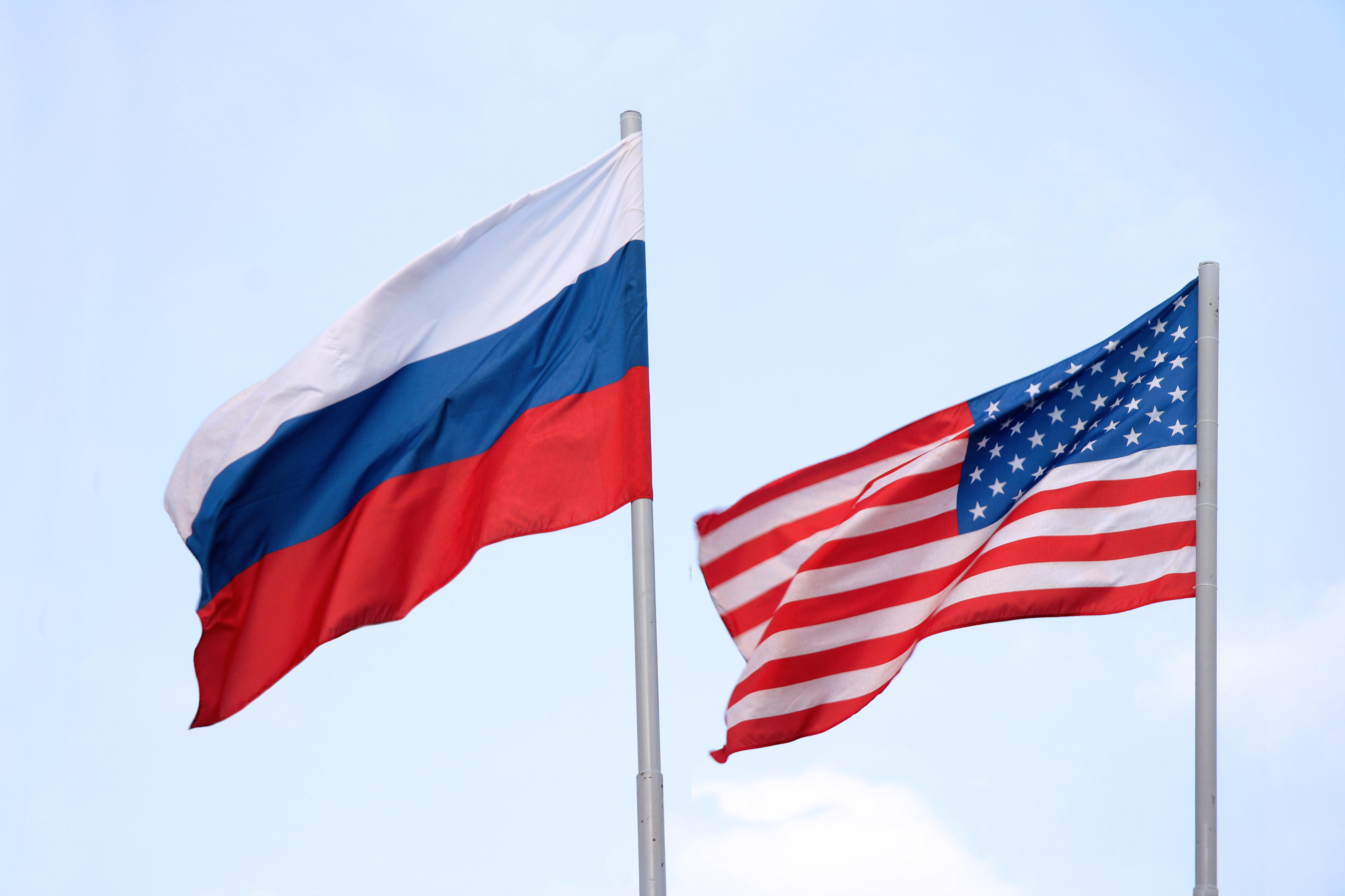 Russian and American flags flying side by side
