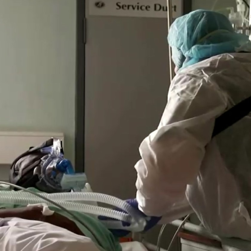South African nurse takes care of an inpatient with coronavirus