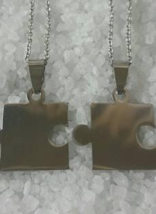 http://articulo.mercadolibre.com.ar/MLA-624354681-dije-doble-acero-puzzle-grabado-2-nombres-regalo-parejas-_JM
