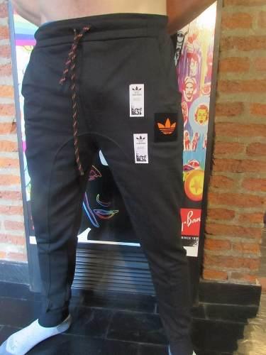 http://articulo.mercadolibre.com.ar/MLA-622226367-pantalon-jogging-chupin-adidas-_JM