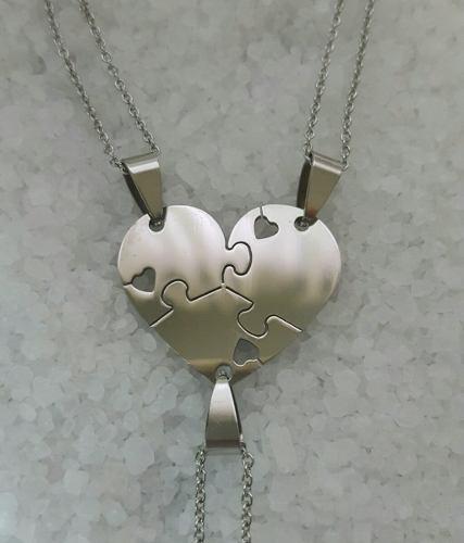 http://articulo.mercadolibre.com.ar/MLA-626266812-triple-dije-acero-puzzle-corazon-grabado-3-nombres-dia-amigo-_JM