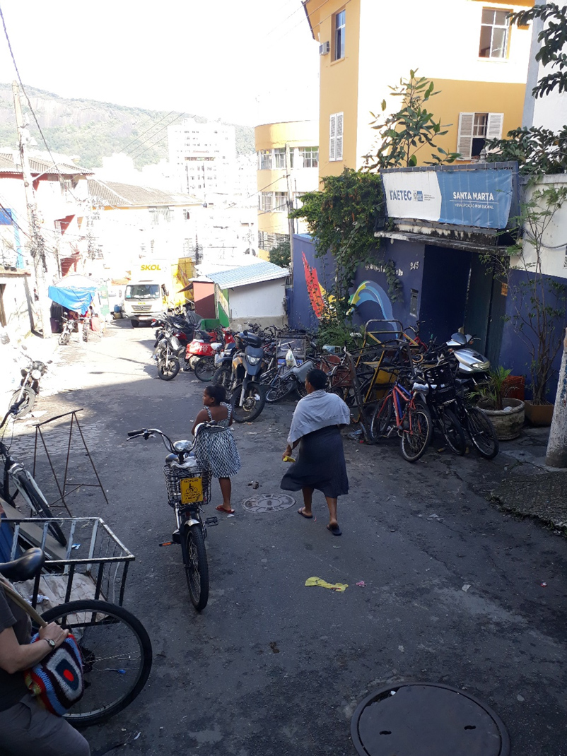 Bicycles, delivery bikes, motorbikes and scooters at the bottom of the 'bondinho'