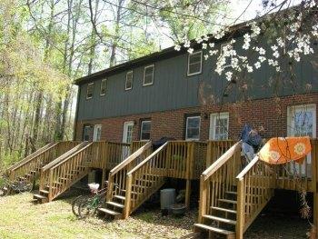House hacking fourplex - after - back yard decks