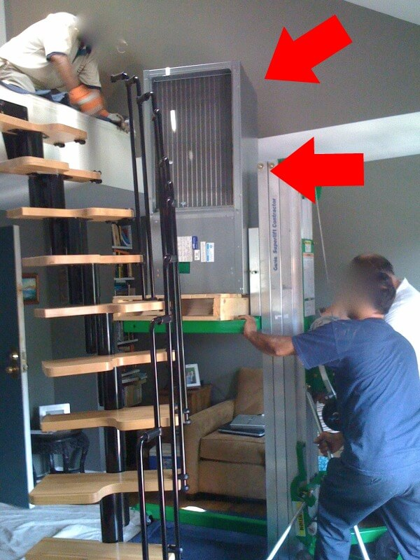 From Accidental Landlord to Positive Cash Flow - Installation of HVAC unit using a lift!
