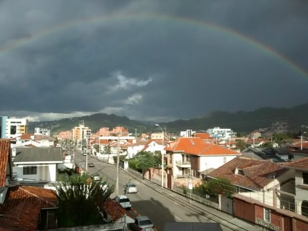 picture of rainbow and green hills in Cuenca Ecuador - How to Travel & Invest In Real Estate – 10 Essential Tools of the Trade