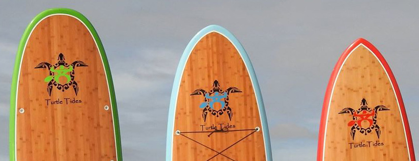 Picture of the Turtle Tides brand stand-up paddle boards.