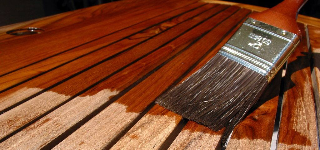 Applying A Wood Coating With A Brush On Decking