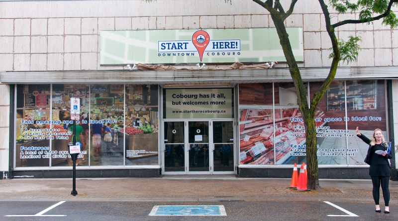 Start Here banner over Sarby's old sign