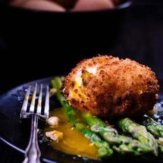 asparagus with crispy hazelnut duck eggs