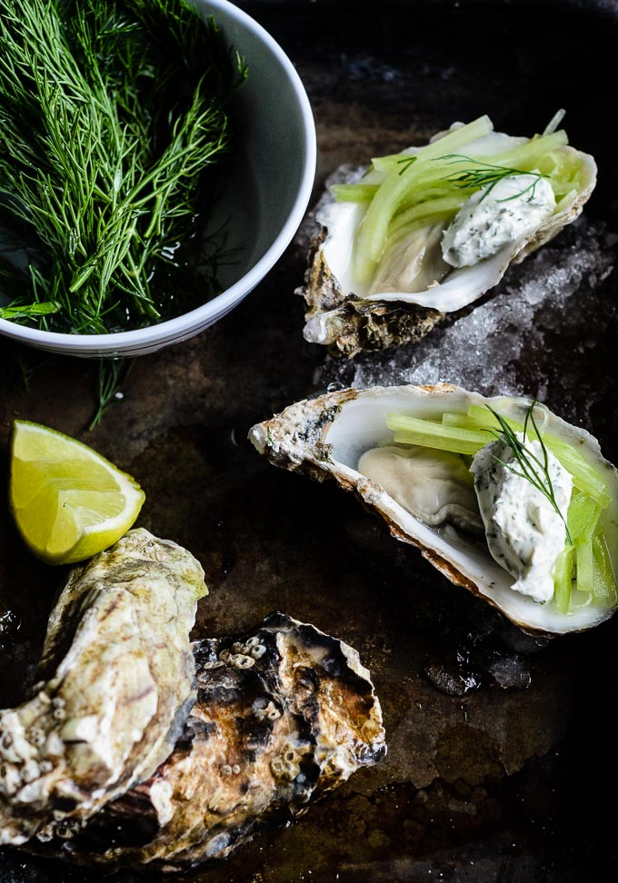 Oysters with pickled cucumber, creme fraiche, and dill