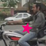 VIRAL: Iranian Motorcyclist only needs one Hand to Steer (& one to Stroke) [NSFW]