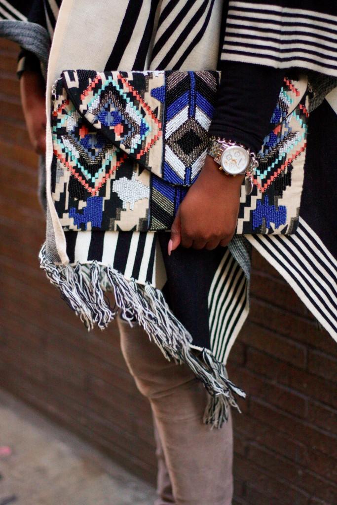 striped cape OTK boots clutch detail