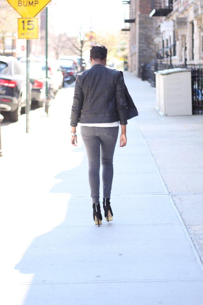 black moto jacket burnout tshirt grey ripped jeans black ankle boots rear