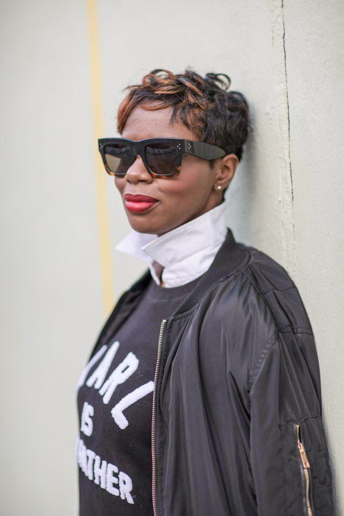 black bomber jacket white blouse black karl boyfriend sweatshirt nyc fashion 2016 side view