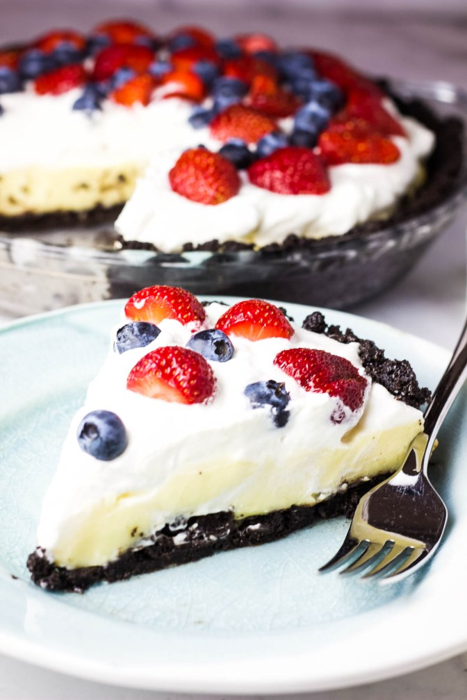 This cool and creamy no-bake white chocolate cream pie is the perfect easy summer dessert. White chocolate is a subtle flavor but it really shines through in this simple custard pie. The chocolate cookie crust and berries are the perfect complement.