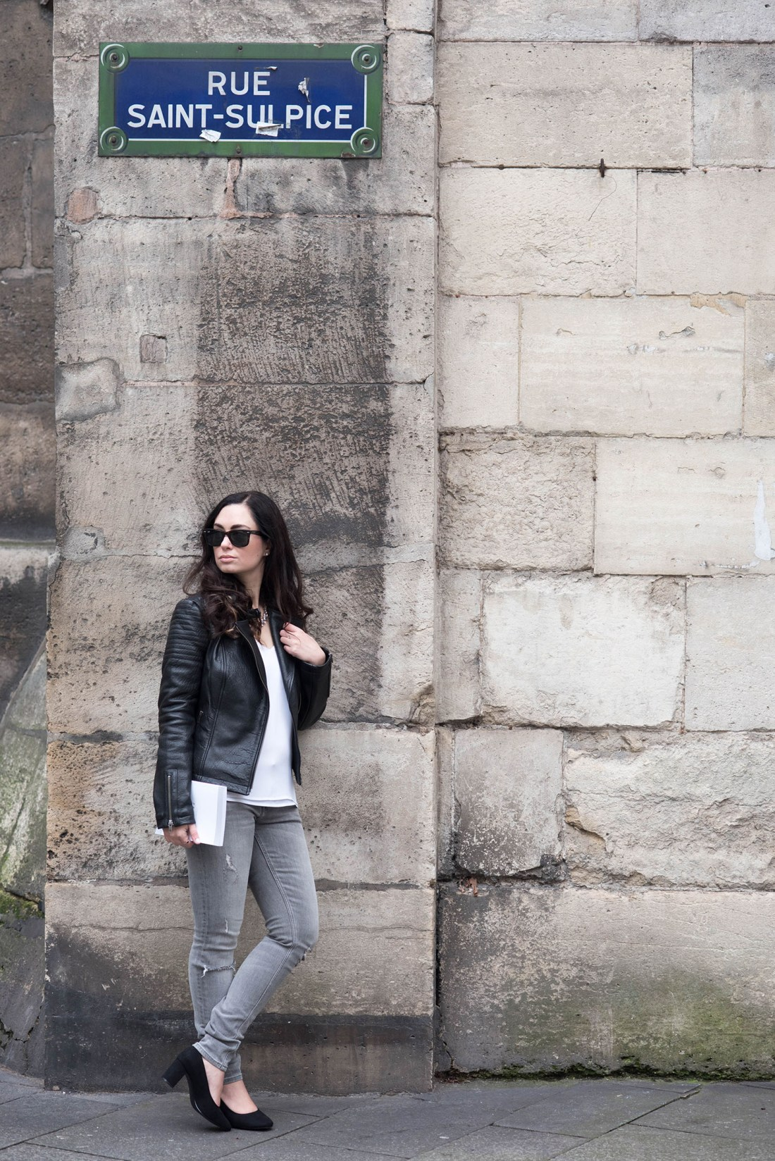 Personal style blogger Cee Fardoe of Coco & Vera stands on rue Saint-Sulpice wearing a Cupcakes & Cashmere jacket