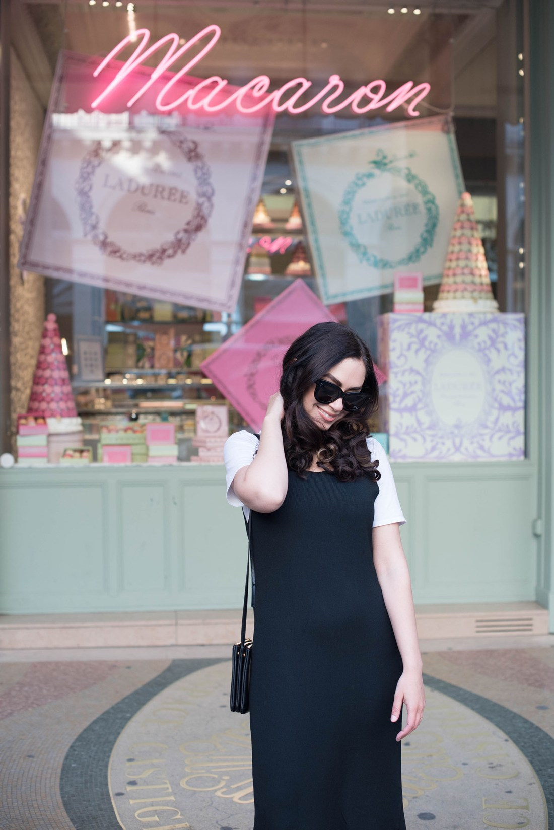 Portrait of style blogger Cee Fardoe of Coco & Vera, wearing a Metisu dress at Laduree in Paris