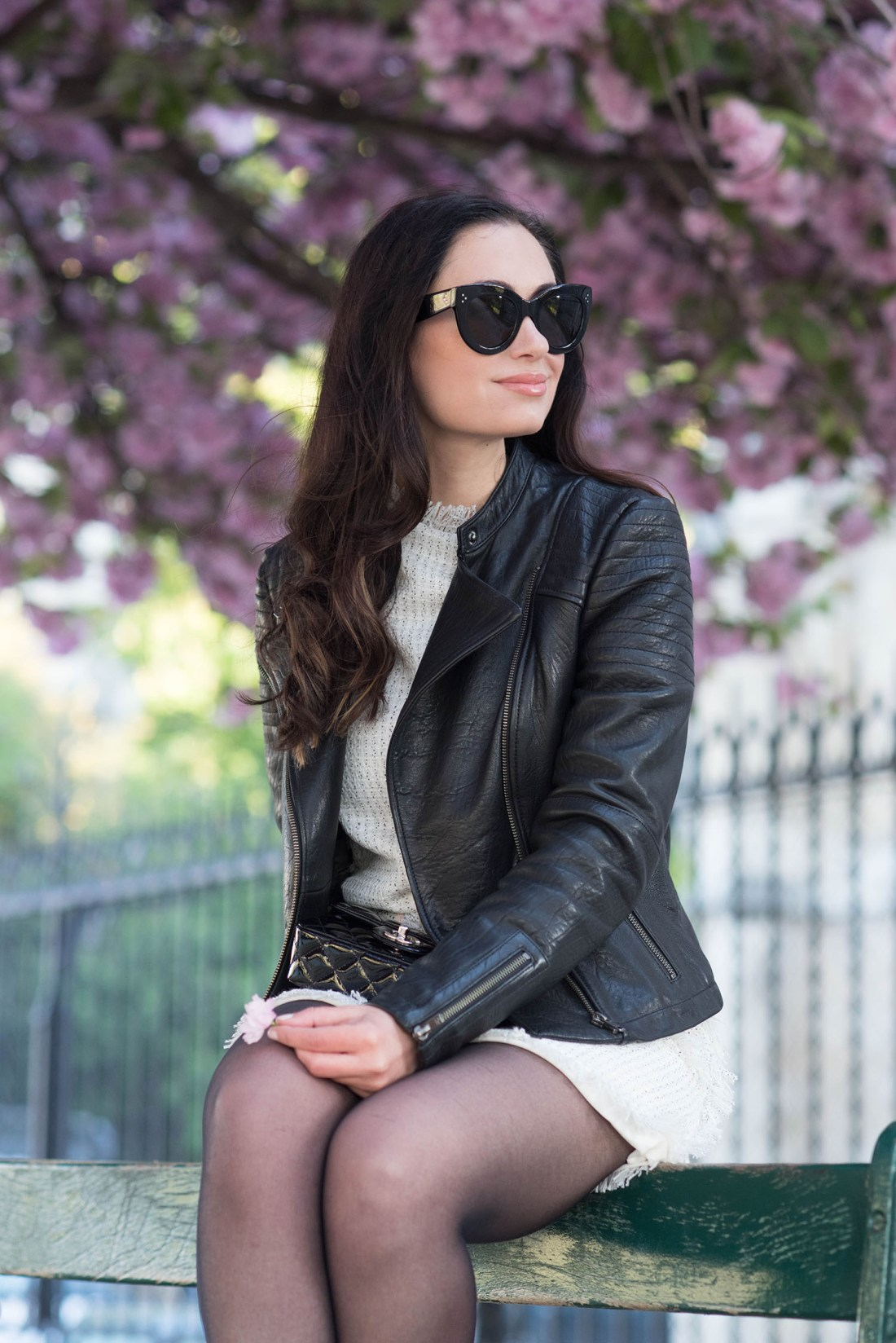 Portrait of style blogger Cee Fardoe of Coco & Vera, wearing a leather jacket and Celine sunglasses