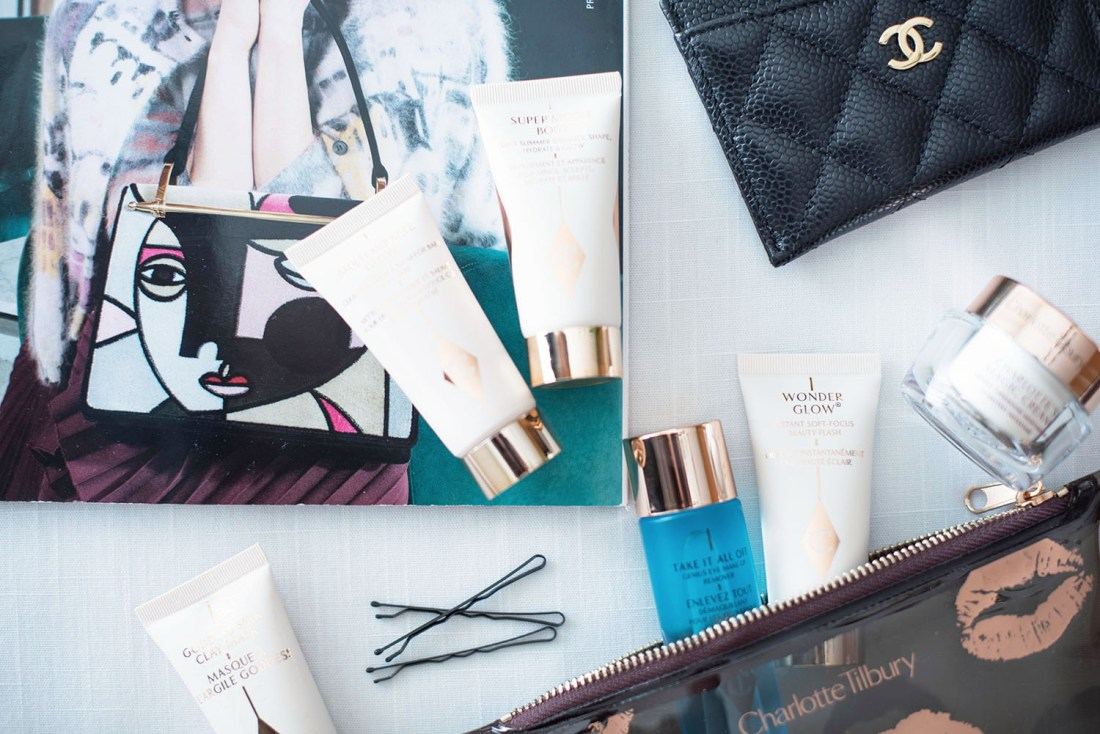 Products from the Charlotte Tilbury Gift of Red Carpet Skin set laid out with a copy of Vogue and a Chanel cardholder, captured by beauty blogger Cee Fardoe of Coco & Vera