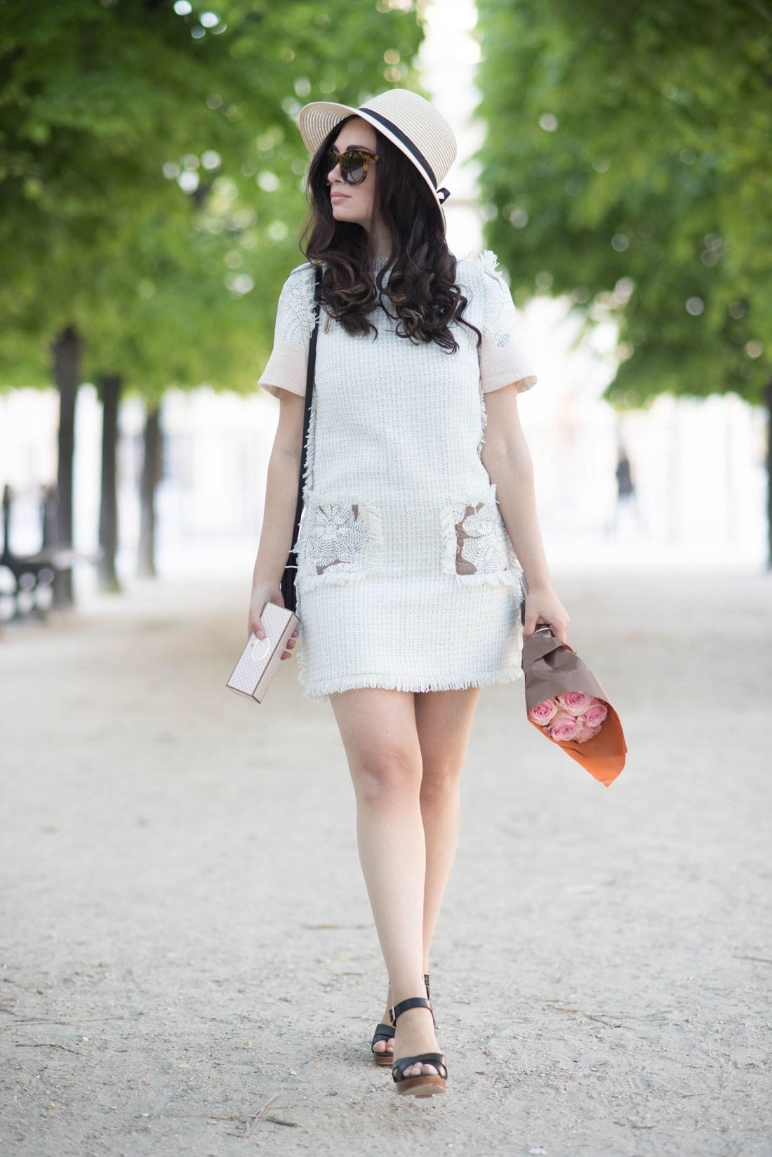 Fashion blogger Cee Fardoe of Coco & Vera walks through the Palais Royal garden wearing a Floriane Fosso dress
