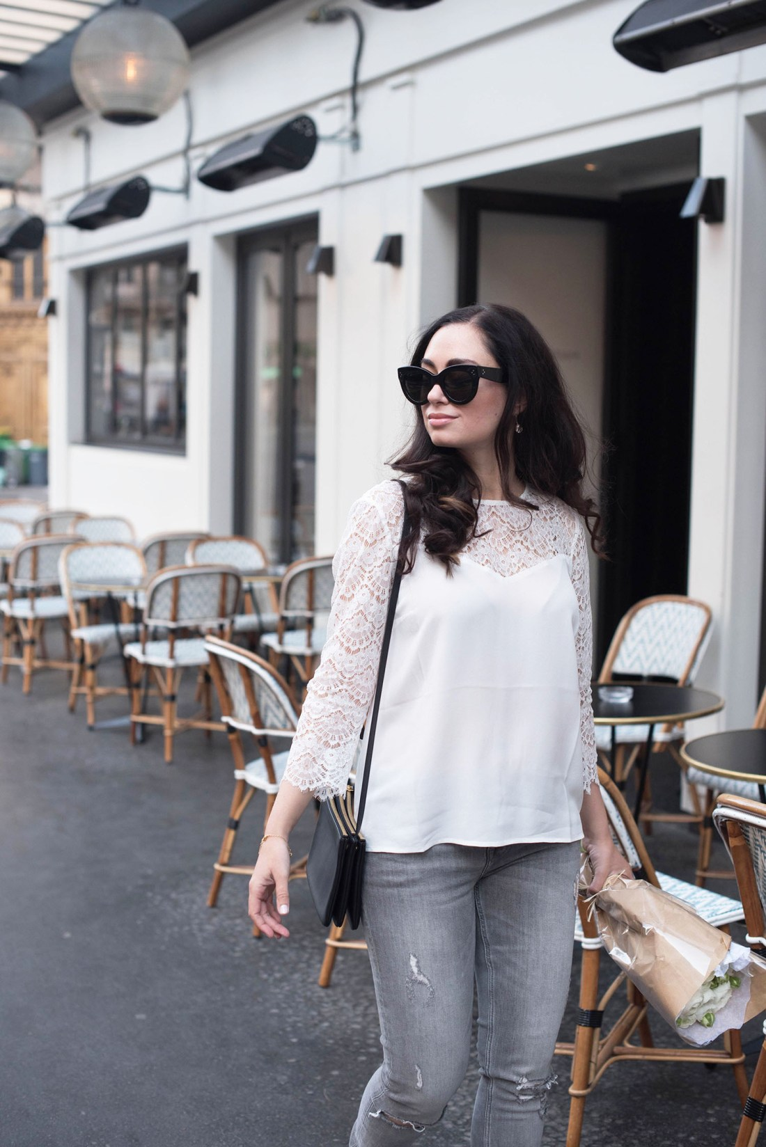 Style blogger Cee Fardoe of Coco & Vera walks past Maison Marie in Paris wearing Celine Audrey sunglasses and grey jeans