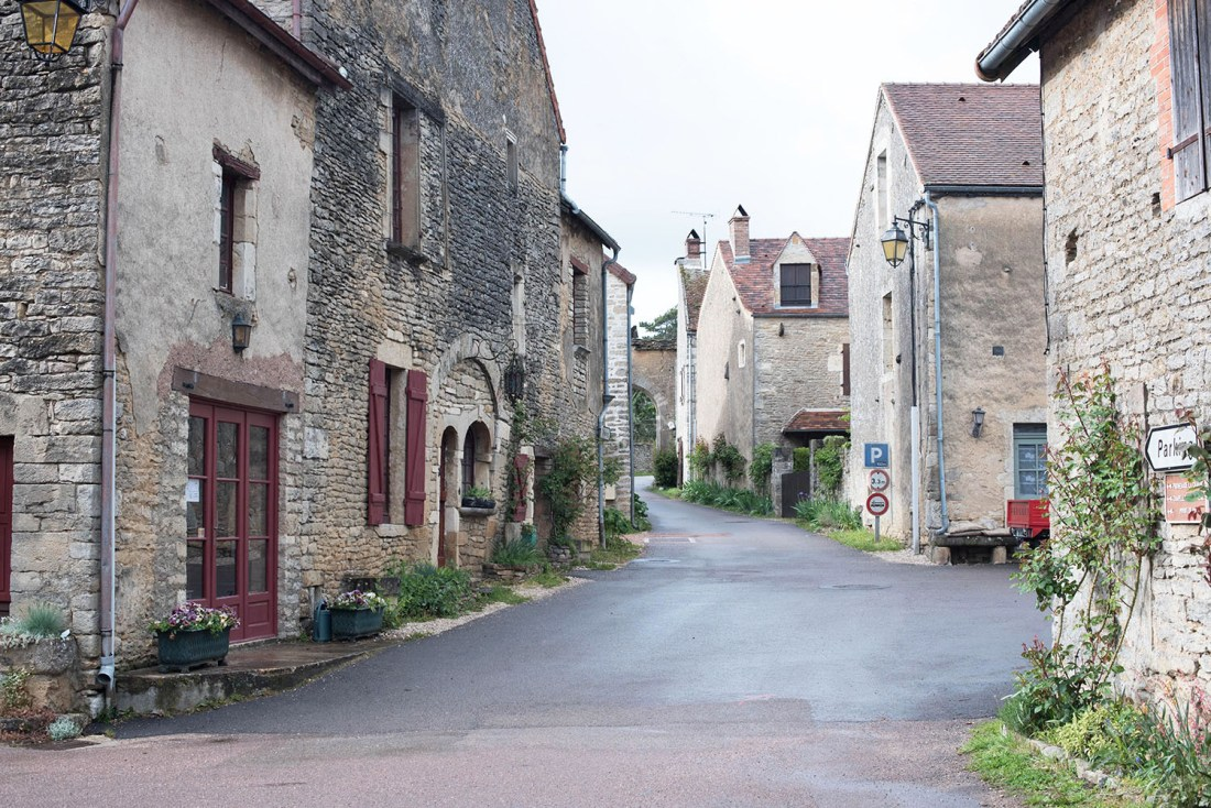 Stone houses in the town of Chateauneuf-en-Auxois in Burgundy, photographed by travel blogger Cee Fardoe of Coco & Vera