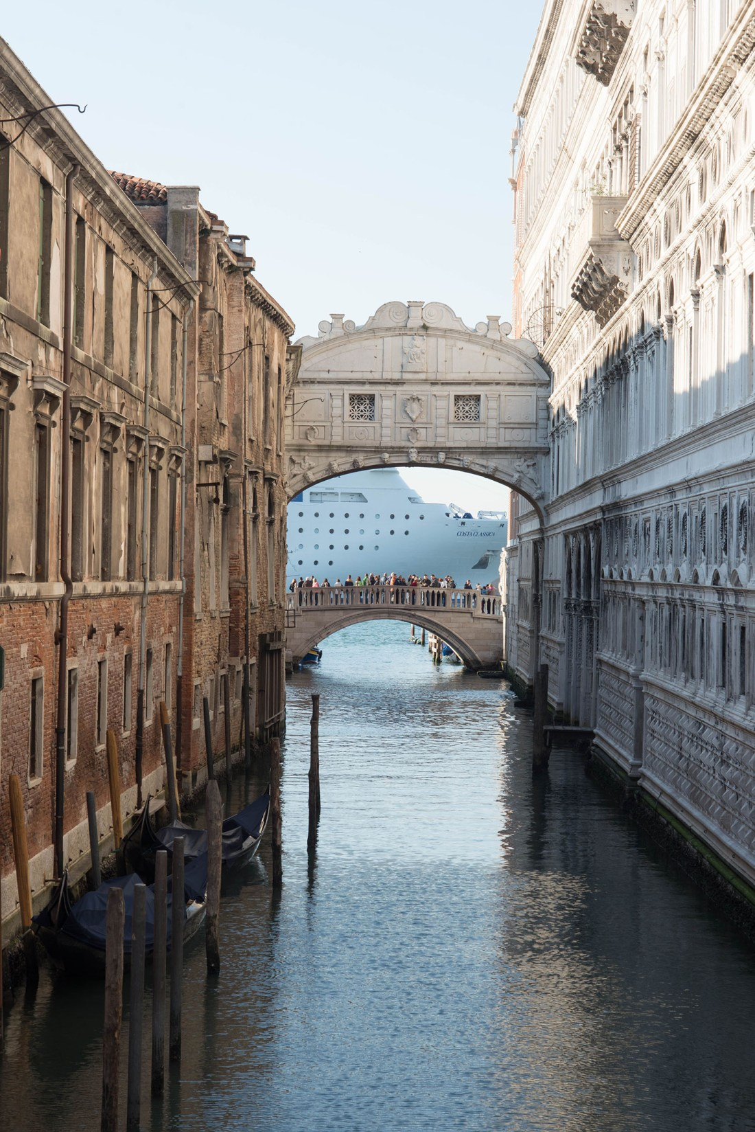 Bridges over a Venetian canal behind St. Mark's Basilica in Italy, as captured by travel blogger Cee Fardoe of Coco & Vera