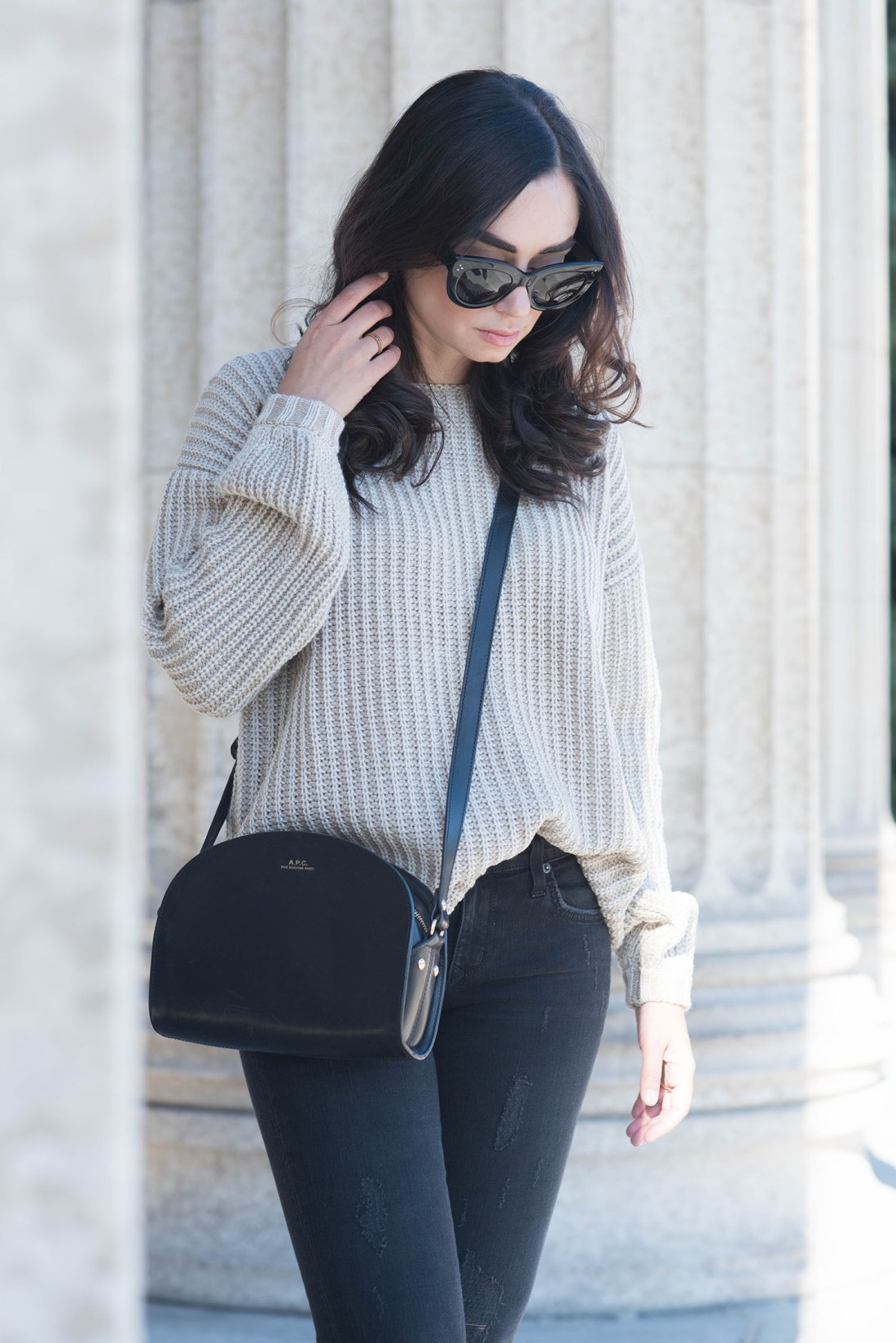 Portrait of fashion blogger Cee Fardoe of Coco & Vera, wearing a Tobi sweater, APC halfmoon bag and Celine sunglasses