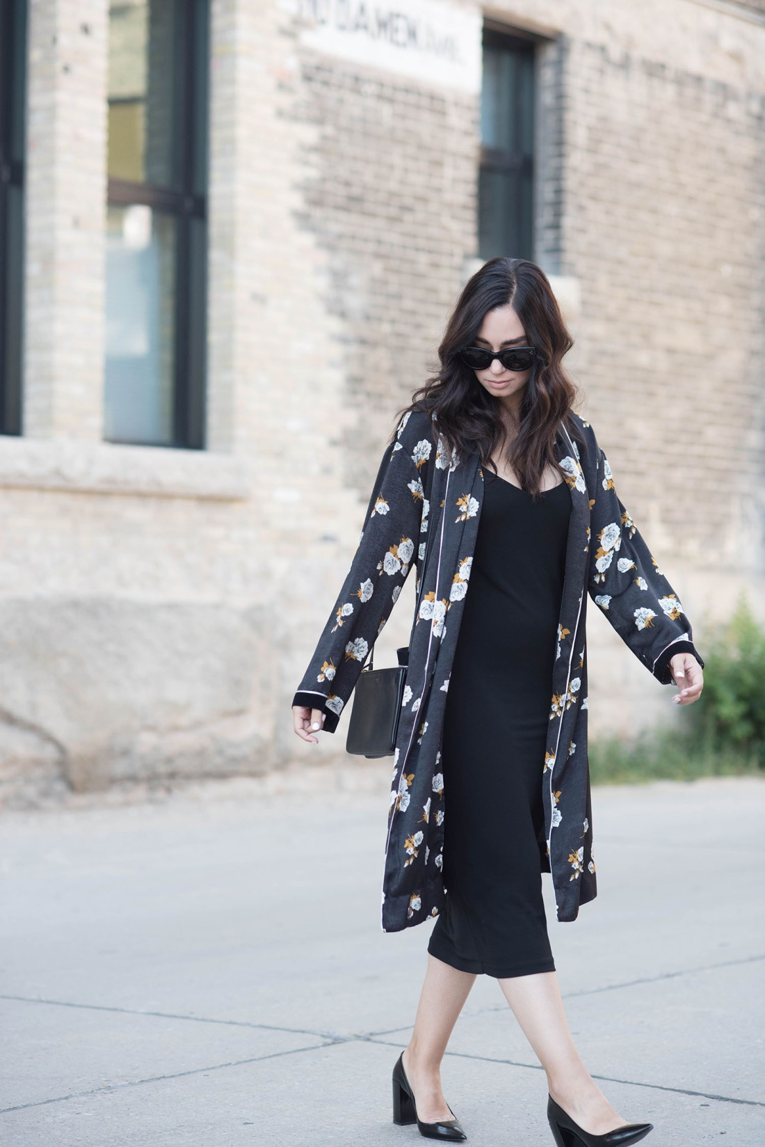 Fashion blogger Cee Fardoe of Coco & Vera walks in the Exchange District of Winnipeg wearing a Zara combined kimono and Pierre Hardy block heels, carrying a Celine trio bag