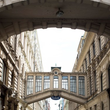 A glass walkway between buildings in the Old Town in Prague, as photographed by travel blogger Cee Fardoe of Coco & Vera