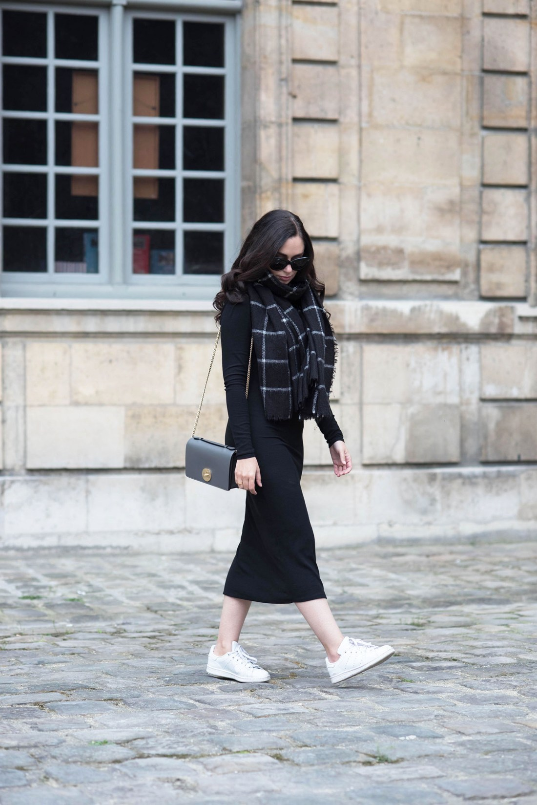 Fashion blogger Cee Fardoe of Coco & Vera walks at Hotel de Sully in Paris wearing a Privacy Please Midway dress and Adidas Stan Smith sneakers