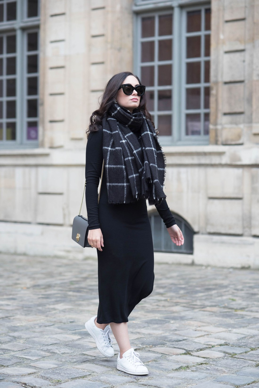Fashion blogger Cee Fardoe of Coco & Vera walks at the Hotel de Sully in Paris wearing a Privacy Please midway dress and Adidas Stan Smith sneakers