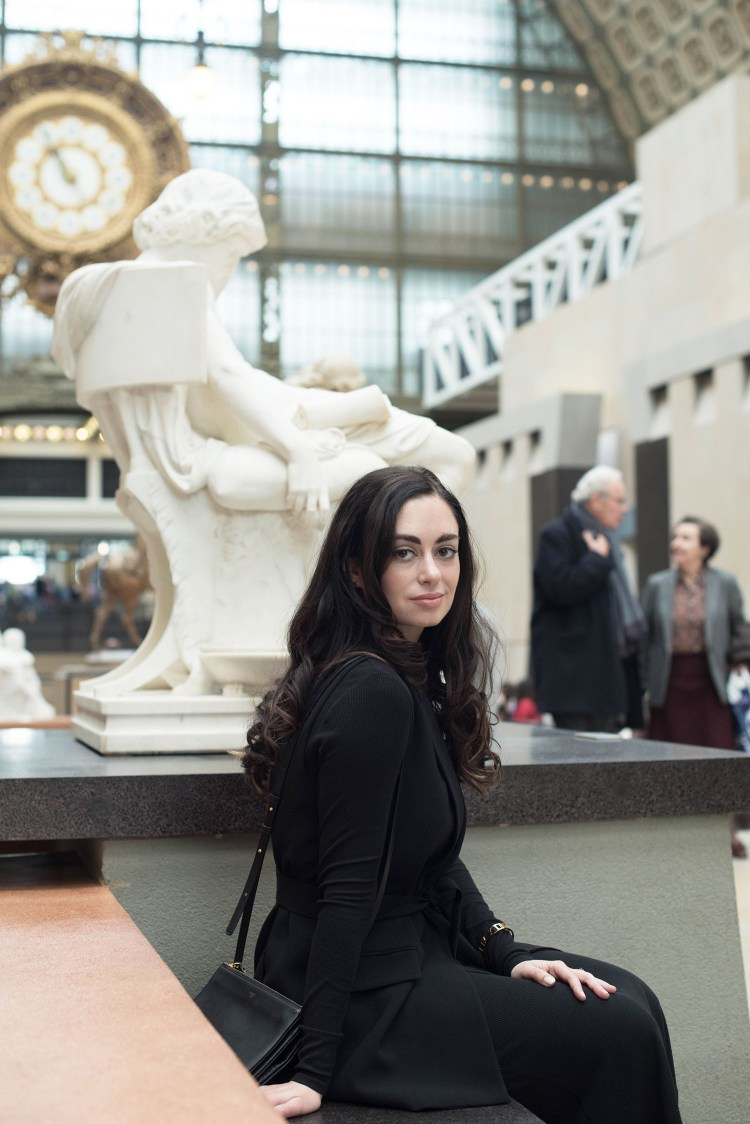 Portrait of brunette fashion blogger Cee Fardoe of Coco & Vera at the Musee d'Orsay in Paris wearing a Zara waistcoat and Celine trio bag