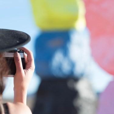 Canadian fashion blogger Cee Fardoe of Coco & Vera talks film photos at Seven Magic Mountains wearing a black ASOS wide brim hat